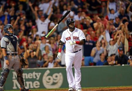 (072615 Boston, MA)Boston Red Sox designated hitter David Ortiz tosses his bat and the crowd celebrates his 3 run home run in the 5th inning.  The Boston Red Sox take of the Detroit Tigers at Fenway Park in Boston.  (Sunday,July 26, 2015). Staff Photo by Nancy Lane