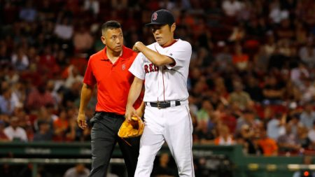 Jul 19, 2016; Boston, MA, USA; Boston Red Sox relief pitcher Koji Uehara (19) is led off the field by a trainer after he was injured while pitching during the ninth inning of the Boston Red Sox 4-0 win over the San Francisco Giants at Fenway Park. Mandatory Credit: Winslow Townson-USA TODAY Sports